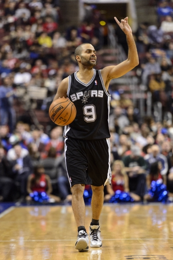 Nov 11, 2013; Philadelphia, PA, USA; San Antonio Spurs guard Tony Parker (9) brings the ball up court during the third quarter against the Philadelphia 76ers at Wells Fargo Center. The Spurs defeated the Sixers 109-85. Mandatory Credit: Howard Smith-USA TODAY Sports