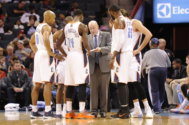 Nov 11, 2013; Charlotte, NC, USA; Charlotte Bobcats head coach Steve Clifford talks to the team during the fourth quarter against the Atlanta Hawks  at Time Warner Cable Arena. The Hawks won 103-94. Mandatory Credit: Sam Sharpe-USA TODAY Sports