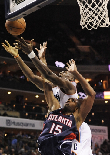 Nov 11, 2013; Charlotte, NC, USA; Atlanta Hawks center forward Al Horford (15) and Charlotte Bobcats forward center Bismack Biyombo (0) battle for a rebound during the third quarter at Time Warner Cable Arena. The Hawks won 103-94. Mandatory Credit: Sam Sharpe-USA TODAY Sports