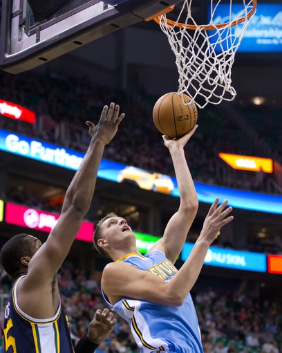 Nov 11, 2013; Salt Lake City, UT, USA; Denver Nuggets center Timofey Mozgov (25) shoots in front of Utah Jazz power forward Derrick Favors (15) during the first half at EnergySolutions Arena. Mandatory Credit: Russ Isabella-USA TODAY Sports