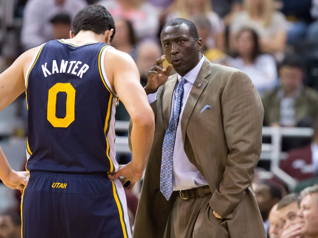 Nov 11, 2013; Salt Lake City, UT, USA; Utah Jazz head coach Tyrone Corbin talks with center Enes Kanter (0) during the first half against the Denver Nuggets at EnergySolutions Arena. Mandatory Credit: Russ Isabella-USA TODAY Sports