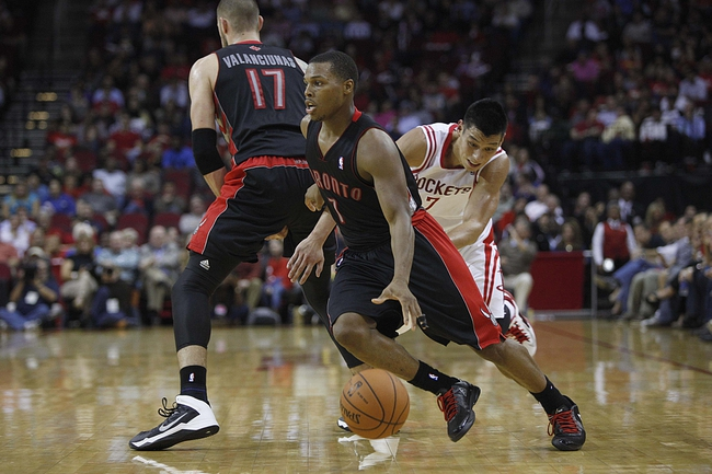 Nov 11, 2013; Houston, TX, USA; Toronto Raptors point guard Kyle Lowry (7) dribbles past Houston Rockets point guard Jeremy Lin (7) during the fourth quarter at Toyota Center. The Rockets won 110-104. Mandatory Credit: Andrew Richardson-USA TODAY Sports