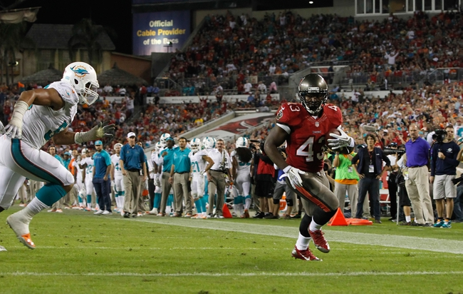 Nov 11, 2013; Tampa, FL, USA; Tampa Bay Buccaneers running back Bobby Rainey (43) runs the ball in for a touchdown against the Miami Dolphins during the second half at Raymond James Stadium. Mandatory Credit: Kim Klement-USA TODAY Sports