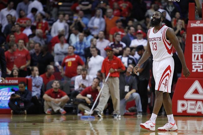 Nov 11, 2013; Houston, TX, USA; Houston Rockets shooting guard James Harden (13) walks off the court following the end of the fourth quarter at Toyota Center. Mandatory Credit: Andrew Richardson-USA TODAY Sports