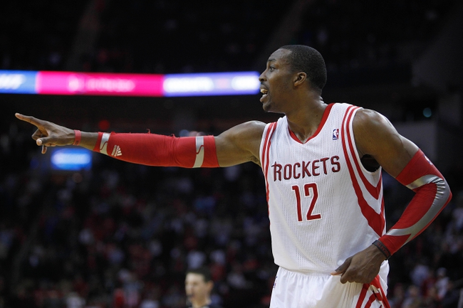 Nov 11, 2013; Houston, TX, USA; Houston Rockets center Dwight Howard (12) yells during the first overtime period at Toyota Center. Mandatory Credit: Andrew Richardson-USA TODAY Sports