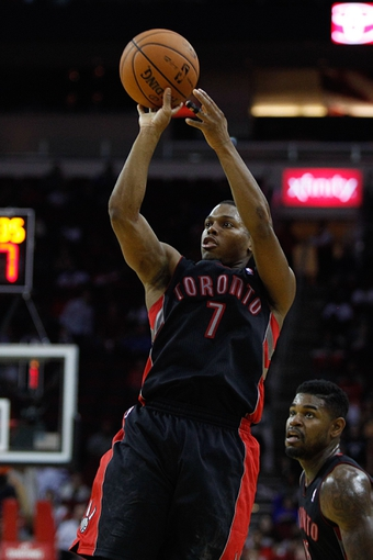 Nov 11, 2013; Houston, TX, USA; Toronto Raptors point guard Kyle Lowry (7) shoots the ball during the second overtime period at Toyota Center. Mandatory Credit: Andrew Richardson-USA TODAY Sports