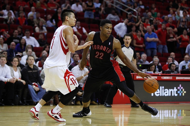 Nov 11, 2013; Houston, TX, USA; Toronto Raptors small forward Rudy Gay (22) drives around Houston Rockets point guard Jeremy Lin (7) during the second overtime period at Toyota Center. Mandatory Credit: Andrew Richardson-USA TODAY Sports