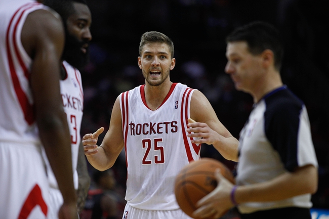 Nov 11, 2013; Houston, TX, USA; Houston Rockets small forward Chandler Parsons (25) talks to an official during the second overtime period at Toyota Center. Mandatory Credit: Andrew Richardson-USA TODAY Sports