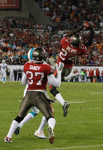 Nov 11, 2013; Tampa, FL, USA; Tampa Bay Buccaneers cornerback Darrelle Revis (24) intercepts the ball against the Miami Dolphins during the second half at Raymond James Stadium. Mandatory Credit: Kim Klement-USA TODAY Sports
