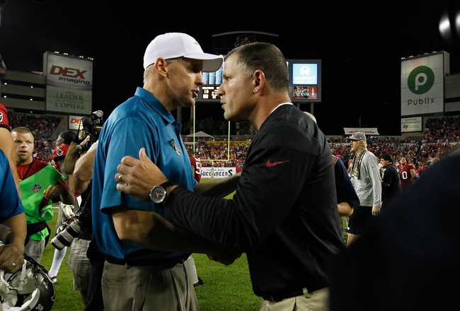 Nov 11, 2013; Tampa, FL, USA; Miami Dolphins head coach Joe Philbin and Tampa Bay Buccaneers head coach Greg Schiano greet at the end of the game at Raymond James Stadium. Mandatory Credit: Kim Klement-USA TODAY Sports