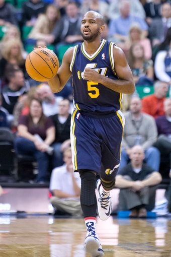 Nov 11, 2013; Salt Lake City, UT, USA; Utah Jazz point guard John Lucas III (5) dribbles up the court during the second half against the Denver Nuggets at EnergySolutions Arena. Denver won 100-81. Mandatory Credit: Russ Isabella-USA TODAY Sports