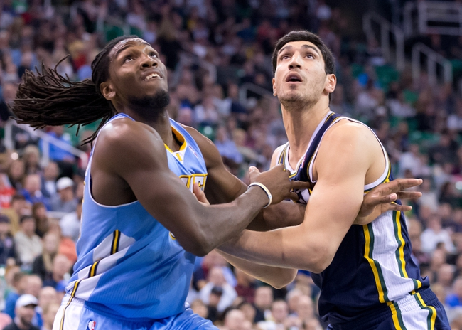 Nov 11, 2013; Salt Lake City, UT, USA; Denver Nuggets power forward Kenneth Faried (35) and Utah Jazz center Enes Kanter (0) battle for position during the second half at EnergySolutions Arena. Denver won 100-81. Mandatory Credit: Russ Isabella-USA TODAY Sports