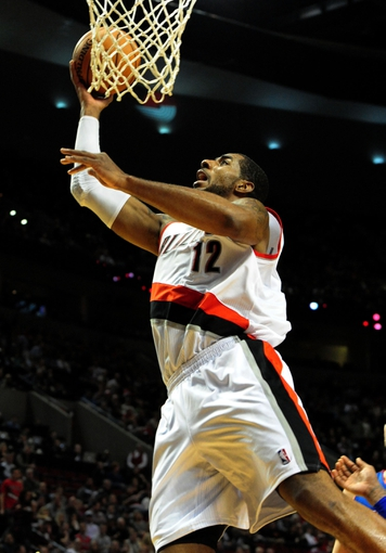Nov 11, 2013; Portland, OR, USA; Portland Trail Blazers power forward LaMarcus Aldridge (12) drives to the basket  during the third quarter of the game against the Detroit Pistons at Moda Center. The Blazers won the game 109-103. Mandatory Credit: Steve Dykes - USA TODAY Sports