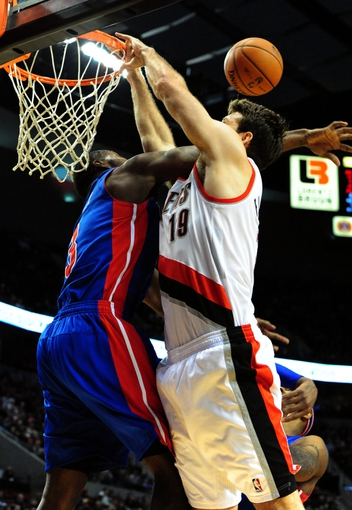 Nov 11, 2013; Portland, OR, USA; Detroit Pistons shooting guard Rodney Stuckey (3) blocks the shot of Portland Trail Blazers center Joel Freeland (19) during the third quarter of the game at Moda Center. The Blazers won the game 109-103. Mandatory Credit: Steve Dykes - USA TODAY Sports