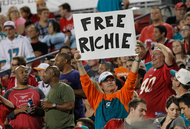 "Nov 11, 2013; Tampa, FL, USA; Miami Dolphins fan hold up a sign for Miami Dolphins guard Richie Incognito (68) (not pictured) sign that says ""Free Richie"" during the second half against the Tampa Bay Buccaneers at Raymond James Stadium. Mandatory Credit: Kim Klement-USA TODAY Sports"