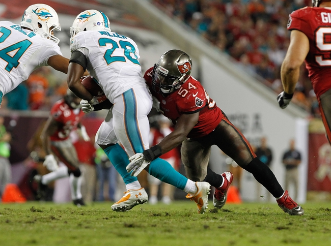 Nov 11, 2013; Tampa, FL, USA; Tampa Bay Buccaneers outside linebacker Lavonte David (54) tackles Miami Dolphins cornerback Nolan Carroll (28) during the second half at Raymond James Stadium. Tampa Bay Buccaneers defeated the Miami Dolphins 22-19. Mandatory Credit: Kim Klement-USA TODAY Sports