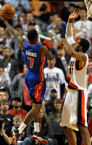 Nov 11, 2013; Portland, OR, USA;  Detroit Pistons point guard Brandon Jennings (7) goes up for a shot on Portland Trail Blazers power forward LaMarcus Aldridge (12) during the fourth quarter of the game at Moda Center. The Blazers won the game 109-103. Mandatory Credit: Steve Dykes - USA TODAY Sports