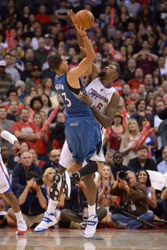 Nov 11, 2013; Los Angeles, CA, USA; Minnesota Timberwolves guard Kevin Martin (23) is defended by Los Angeles Clippers center DeAndre Jordan (6) at Staples Center. The Clippers defeated the Timberwolves 109-107. Mandatory Credit: Kirby Lee-USA TODAY Sports