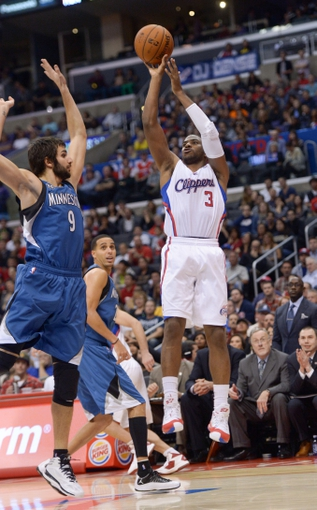 Nov 11, 2013; Los Angeles, CA, USA; Los Angeles Clippers guard Chris Paul (3) shoots the ball as Minnesota Timberwolves guard Ricky Rubio (9) defends at Staples Center. The Clippers defeated the Timberwolves 109-107. Mandatory Credit: Kirby Lee-USA TODAY Sports