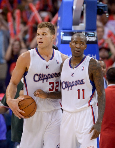 Nov 11, 2013; Los Angeles, CA, USA; Los Angeles Clippers forward Blake Griffin (32) and guard Jamal Crawford (11) react at the end of the game against the Minnesota Timberwolves at Staples Center. The Clippers defeated the Timberwolves 109-107. Mandatory Credit: Kirby Lee-USA TODAY Sports