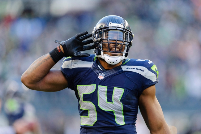 Nov 3, 2013; Seattle, WA, USA; Seattle Seahawks middle linebacker Bobby Wagner (54) celebrates after recording a sack against the Tampa Bay Buccaneers during the game at CenturyLink Field. Seattle defeated Tampa Bay 27-24. Mandatory Credit: Steven Bisig-USA TODAY Sports
