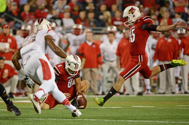 Oct 10, 2013; Louisville, KY, USA; Louisville Cardinals punter John Wallace (45) attempts to kick a field goal against the Rutgers Scarlet Knights  at Papa John's Cardinal Stadium. Mandatory Credit: Jamie Rhodes-USA TODAY Sports
