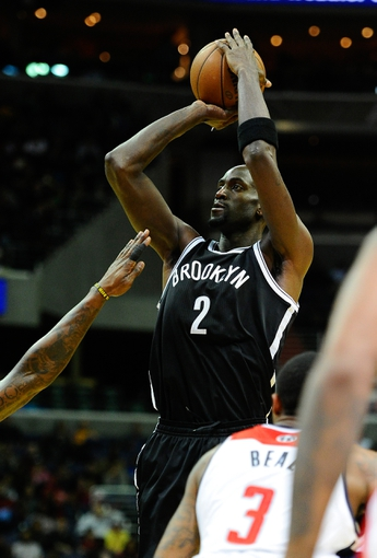 Nov 8, 2013; Washington, DC, USA; Brooklyn Nets power forward Kevin Garnett (2) shoots a jump shot against the Washington Wizards during the second half at the Verizon Center. The Wizards defeated the Nets 112 - 108. Mandatory Credit: Brad Mills-USA TODAY Sports