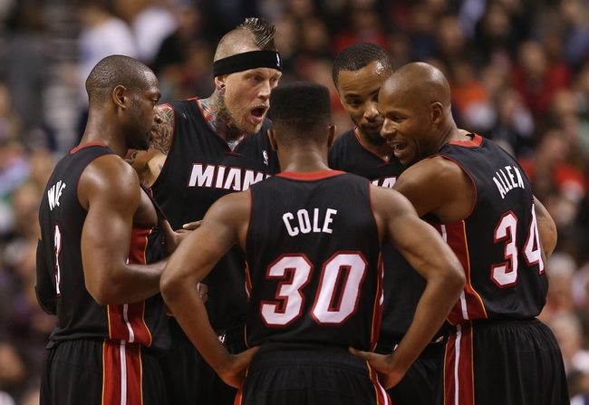 Nov 5, 2013; Toronto, Ontario, CAN; Miami Heat guard Dwyane Wade (3) talks to forward Chris Andersen (11) and point guard Norris Cole (30) and forward Rashard Lewis (9) and guard Ray Allen (34) against the Toronto Raptors at Air Canada Centre. The Heat beat the Raptors 104-95. Mandatory Credit: Tom Szczerbowski-USA TODAY Sports