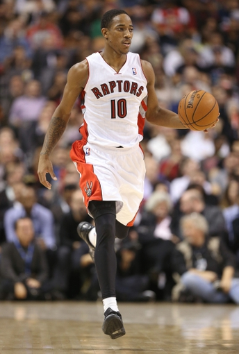 Nov 5, 2013; Toronto, Ontario, CAN; Toronto Raptors guard DeMar DeRozan (10) brings the ball up the court against the Miami Heat at Air Canada Centre. The Heat beat the Raptors 104-95. Mandatory Credit: Tom Szczerbowski-USA TODAY Sports