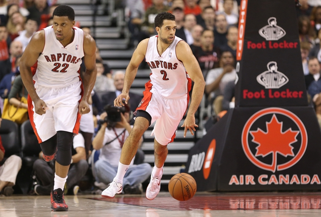 Nov 5, 2013; Toronto, Ontario, CAN; Toronto Raptors forward Landry Fields (2) brings the ball up the court with forward Rudy Gay (22) beside him against the Miami Heat at Air Canada Centre. The Heat beat the Raptors 104-95. Mandatory Credit: Tom Szczerbowski-USA TODAY Sports