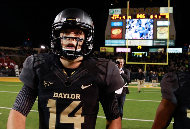 Nov 7, 2013; Waco, TX, USA;  Baylor Bears quarterback Bryce Petty (14) walks off the field after the game against the Oklahoma Sooners at Floyd Casey Stadium. Baylor beat Oklahoma 41-12. Mandatory Credit: Tim Heitman-USA TODAY Sports