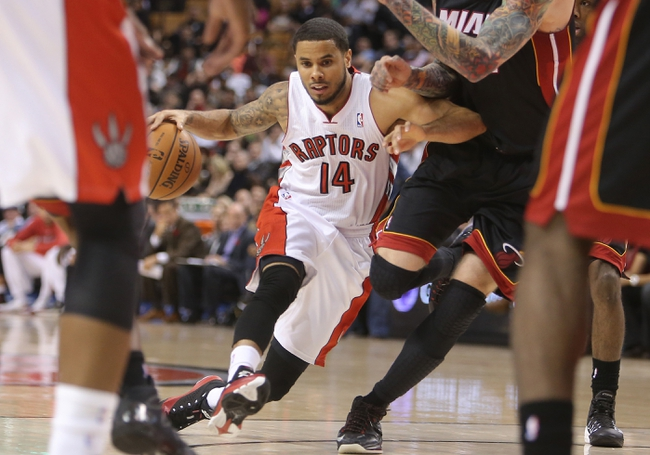 Nov 5, 2013; Toronto, Ontario, CAN; Toronto Raptors point guard D.J. Augustin (14) drives to the basket against the Miami Heat at Air Canada Centre. The Heat beat the Raptors 104-95. Mandatory Credit: Tom Szczerbowski-USA TODAY Sports