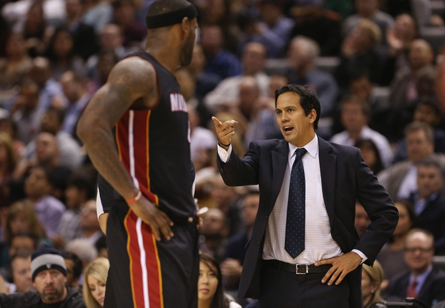 Nov 5, 2013; Toronto, Ontario, CAN; Miami Heat head coach Erik Spoelstra and forward LeBron James (6) during their game against the Toronto Raptors at Air Canada Centre. The Heat beat the Raptors 104-95. Mandatory Credit: Tom Szczerbowski-USA TODAY Sports