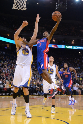 November 12, 2013; Oakland, CA, USA; Detroit Pistons point guard Brandon Jennings (7) drives to the basket against Golden State Warriors center Andrew Bogut (12) during the first quarter at Oracle Arena. Mandatory Credit: Kyle Terada-USA TODAY Sports