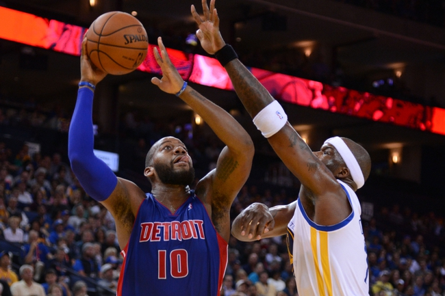 November 12, 2013; Oakland, CA, USA; Detroit Pistons power forward Greg Monroe (10) shoots the ball against Golden State Warriors center Jermaine O'Neal (7, right) during the second quarter at Oracle Arena. Mandatory Credit: Kyle Terada-USA TODAY Sports