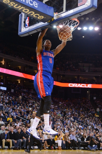 November 12, 2013; Oakland, CA, USA; Detroit Pistons shooting guard Kentavious Caldwell-Pope (5) dunks the ball against the Golden State Warriors during the second quarter at Oracle Arena. Mandatory Credit: Kyle Terada-USA TODAY Sports