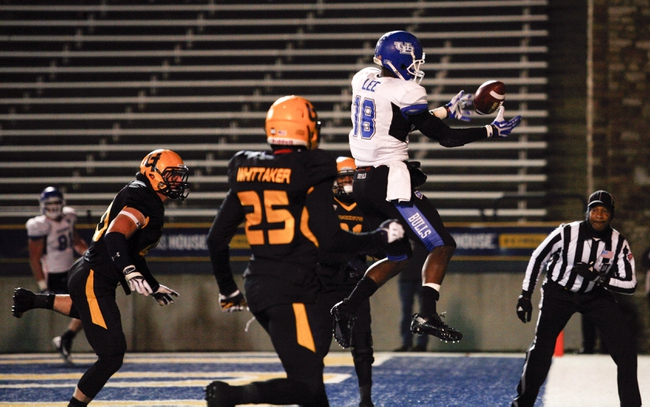 Nov 12, 2013; Toledo, OH, USA; Buffalo Bulls wide receiver Fred Lee (18) drops a pass in the end zone during the fourth quarter against the Toledo Rockets at Glass Bowl. The Rockets beat the Bulls 51-41. Mandatory Credit: Raj Mehta-USA TODAY Sports