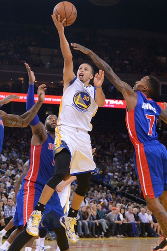 November 12, 2013; Oakland, CA, USA; Golden State Warriors point guard Stephen Curry (30) shoots the ball against the Detroit Pistons during the third quarter at Oracle Arena. The Warriors defeated the Pistons 113-95. Mandatory Credit: Kyle Terada-USA TODAY Sports
