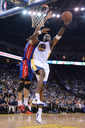 November 12, 2013; Oakland, CA, USA; Golden State Warriors center Jermaine O'Neal (7) shoots the ball against the Detroit Pistons during the third quarter at Oracle Arena. The Warriors defeated the Pistons 113-95. Mandatory Credit: Kyle Terada-USA TODAY Sports
