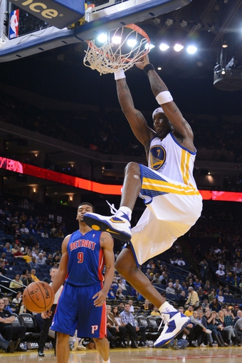 November 12, 2013; Oakland, CA, USA; Golden State Warriors center Jermaine O'Neal (7) dunks the ball against the Detroit Pistons during the fourth quarter at Oracle Arena. The Warriors defeated the Pistons 113-95. Mandatory Credit: Kyle Terada-USA TODAY Sports