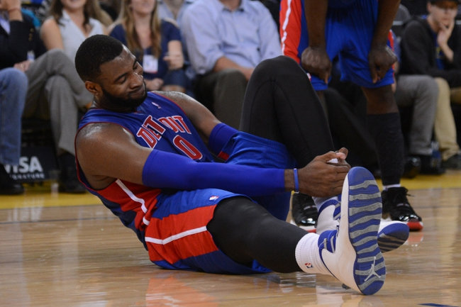 November 12, 2013; Oakland, CA, USA; Detroit Pistons center Andre Drummond (0) reacts after an injury against the Golden State Warriors during the fourth quarter at Oracle Arena. The Warriors defeated the Pistons 113-95. Mandatory Credit: Kyle Terada-USA TODAY Sports