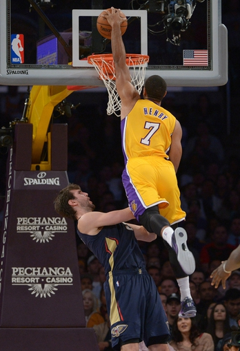 Nov 12, 2013; Los Angeles, CA, USA; Los Angeles Lakers forward Xavier Henry (7) dunks the ball against New Orleans Pelicans center Jeff Withey (5) at Staples Center. The Lakers defeated the Pelicans 116-95. Mandatory Credit: Kirby Lee-USA TODAY Sports