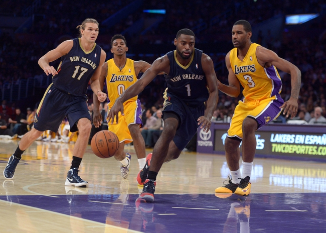 Nov 12, 2013; Los Angeles, CA, USA; New Orleans Pelicans guard Tyreke Evans (1) is defended by Los Angeles Lakers forward Shawne Williams (3) at Staples Center. The Lakers defeated the Pelicans 116-95. Mandatory Credit: Kirby Lee-USA TODAY Sports