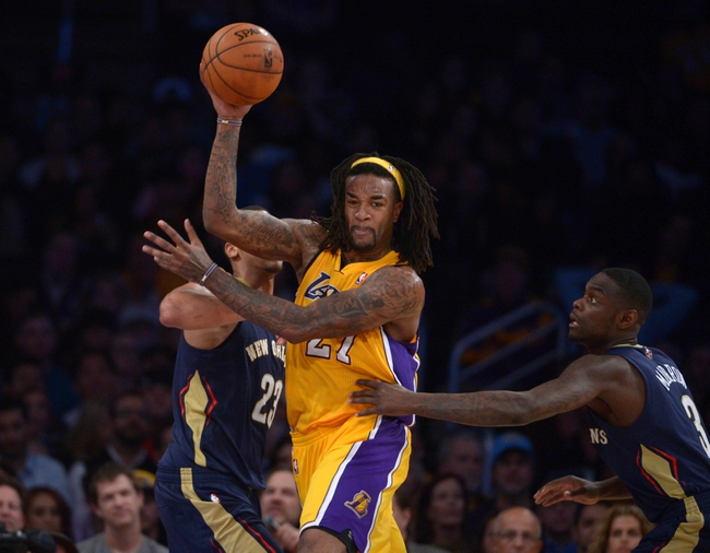 Nov 12, 2013; Los Angeles, CA, USA; Los Angeles Lakers forward Jordan Hill (27) is defended by New Orleans Pelicans forward Anthony Davis (23) and guard Anthony Morrow (3) at Staples Center. The Lakers defeated the Pelicans 116-95. Mandatory Credit: Kirby Lee-USA TODAY Sports