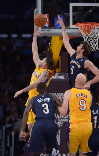 Nov 12, 2013; Los Angeles, CA, USA; New Orleans Pelicans center Jeff Withey (5) blocks a shot by Los Angeles Lakers guard Jordan Farmar (1) at Staples Center. The Lakers defeated the Pelicans 116-95. Mandatory Credit: Kirby Lee-USA TODAY Sports