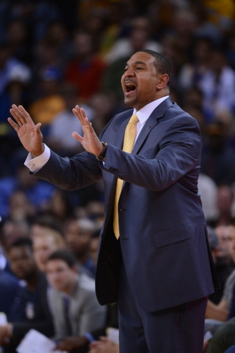 November 12, 2013; Oakland, CA, USA; Golden State Warriors head coach Mark Jackson instructs against the Detroit Pistons during the first quarter at Oracle Arena. The Warriors defeated the Pistons 113-95. Mandatory Credit: Kyle Terada-USA TODAY Sports