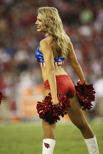 Nov 10, 2013; Phoenix, AZ, USA; Arizona Cardinals cheerleader performs during the game against the Houston Texans at University of Phoenix Stadium. Arizona won 27-24. Mandatory Credit: Kevin Jairaj-USA TODAY Sports
