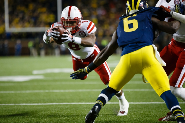 Nov 9, 2013; Ann Arbor, MI, USA; Nebraska Cornhuskers running back Ameer Abdullah (8) runs the ball for a touchdown against the Michigan Wolverines at Michigan Stadium. Mandatory Credit: Rick Osentoski-USA TODAY Sports