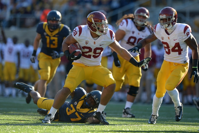 Nov 9, 2013; Berkeley, CA, USA; Southern California Trojans tailback Ty Isaac (29) rushes for a touchdown against the California Golden Bears at Memorial Stadium. USC defeated California 62-28. Mandatory Credit: Kirby Lee-USA TODAY Sports
