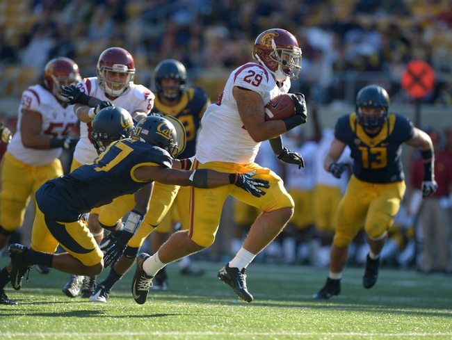 Nov 9, 2013; Berkeley, CA, USA; Southern California Trojans tailback Ty Isaac (29) rushes for a touchdown as California Golden Bears cornerback Cedric Dozier (37) defends at Memorial Stadium. USC defeated California 62-28. Mandatory Credit: Kirby Lee-USA TODAY Sports